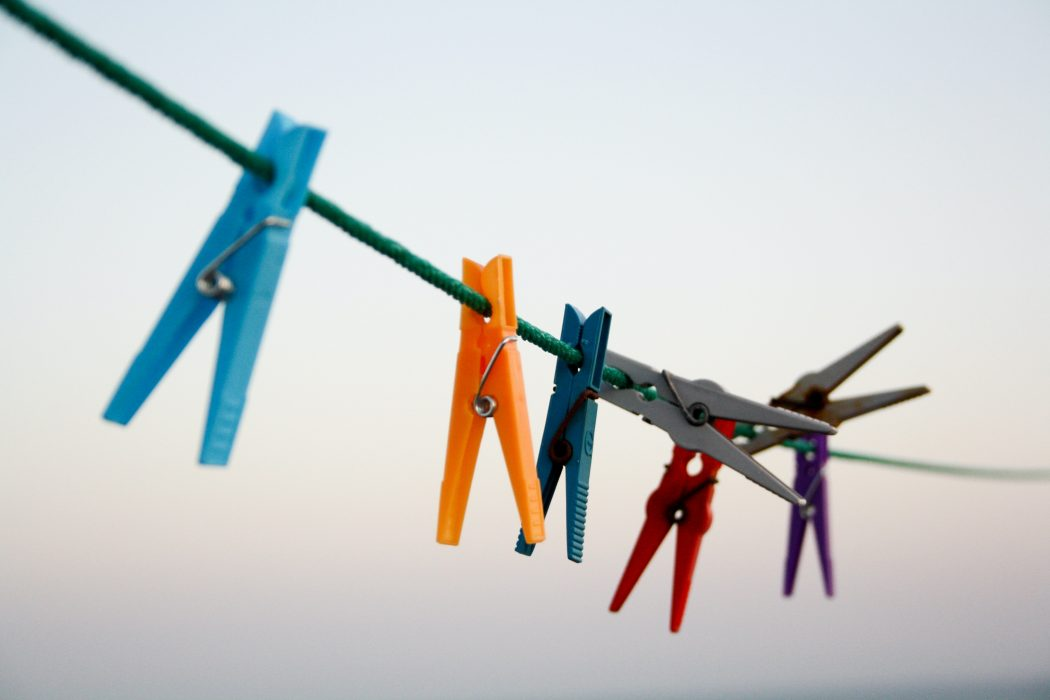 a row of coloured pegs on a washing line